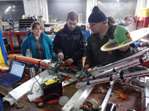 One of our team members explains the robot to his parents.