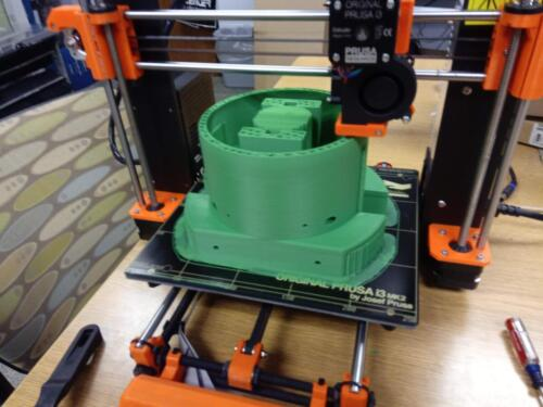 The 2019 hatch capture mechanism in the middle of printing.