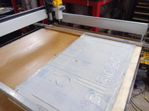 Cutting an electrinics bay cover on our CNC router.