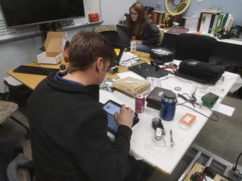 Tean Mentor Adam Anderson working on revisions to a climber design ahead of a trip to tour 3D printer.